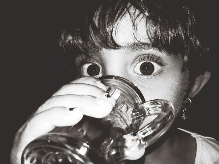 Close-Up Portrait Of Girl Having Drink