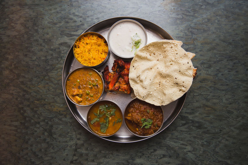 Bowl Chicken Tandoori Close-up DIP Directly Above Food Food And Drink Freshness Healthy Eating High Angle View India Indian Food Indoors  Mutton Curry Nan No People Papadum Plate Pulao Rice Raita Ready-to-eat Serving Size Subji Table