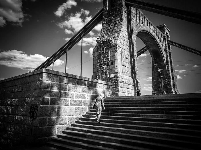 grunwaldzki bridge Architecture Igerswroclaw Wroclaw Visitwroclaw Mostgrunwaldzki Clouds Blackandwhite Woman Bridge Cityphotography Polandphotos Streetphoto Fotografwroclaw Built Structure Stairs The Street Photographer - 2018 EyeEm Awards