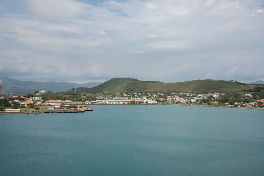 NOUMEA,NEW CALEDONIA-NOVEMBER 25,2016: Waterfront, green landscape and Pacific Ocean in Noumea, New Caledonia. Noumea Architecture Building Exterior Built Structure City Cityscape Cloud - Sky Commercial Dock Greenery Harbor Island Landscape Mountain Mountain Range Nature Nautical Vessel New Caledonia Outdoors Pacific Ocean Scenics Sea Tower Travel Destinations Water Waterfront