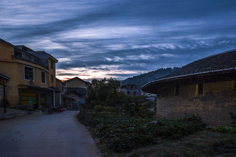 Tulou Tulou is the most extraordinary type of Chinese rural dwellings of the Hakka and others in the mountainous areas in southeastern Fujian, China. Alley Morning HUAWEI Photo Award: After Dark TuLou China Architecture Building Building Exterior Built Structure Cloud - Sky Hakka Nature No People Outdoors Plant Road Rural Dwellings Sky Street The Way Forward Tulou