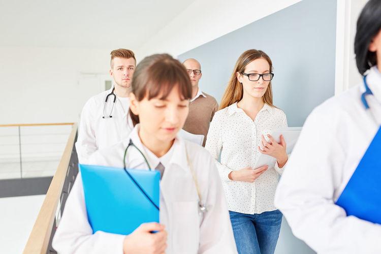 Doctors walking in corridor at hospital