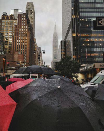 Close-Up Of Umbrellas In City During Rainy Season