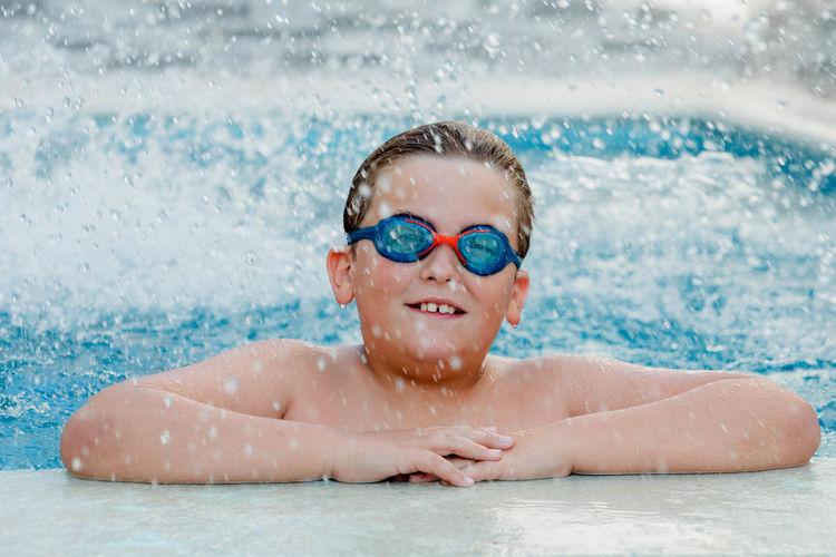 Portrait of happy girl swimming in pool