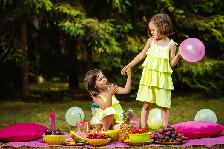 Picnic Forest Summer Childhood Child Girls Two People Females Women Togetherness Family Leisure Activity Bonding Food Happiness Smiling Real People Food And Drink Emotion Casual Clothing Offspring Enjoyment Outdoors Daughter