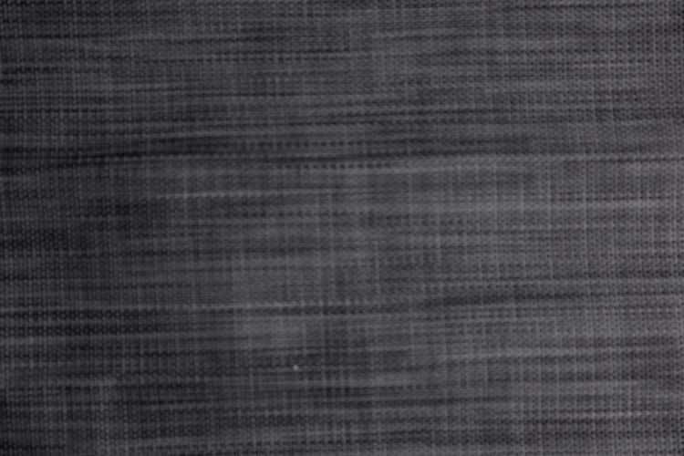 Macro shot of metal grate against black background