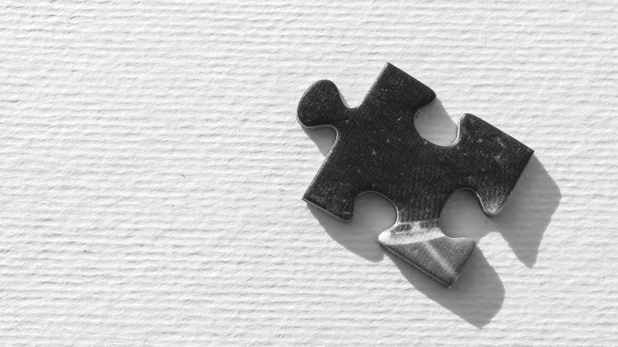 Close-Up Of Puzzle Piece On Table