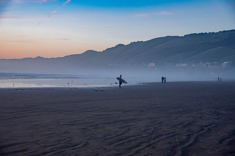 Water Sky Beach Land Mountain Sea Beauty In Nature Real People Scenics - Nature Sunset Lifestyles Nature Leisure Activity Sand Silhouette Tranquility People Holiday Tranquil Scene Outdoors