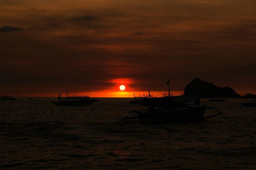 #Boats Sunset Silhouettes Orange Sea And Sky Sea Sunset Philippines Nature Philippine Sunset Travel Destinations Sand Silhouette Sky Water Horizon Over Water Vacations Nature No People Beauty In Nature Day