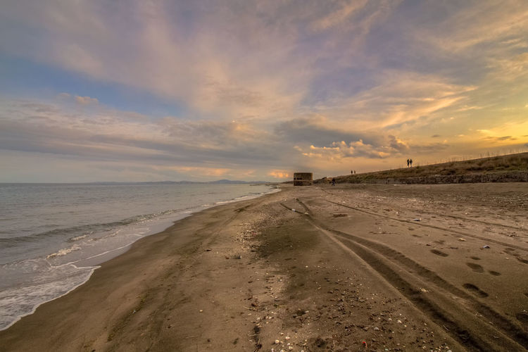 Sky Sea Land Water Cloud - Sky Scenics - Nature Horizon Beach Horizon Over Water Beauty In Nature Sunset Sand Tranquil Scene Nature Tranquility No People Direction Non-urban Scene Outdoors