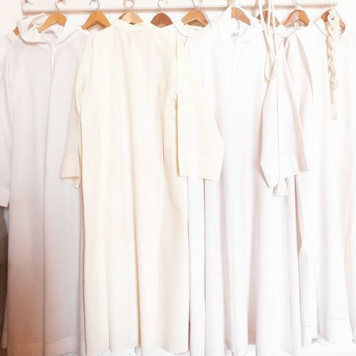 Close-up of white clothes hanging in store