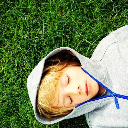 Portrait of cute girl lying on grass