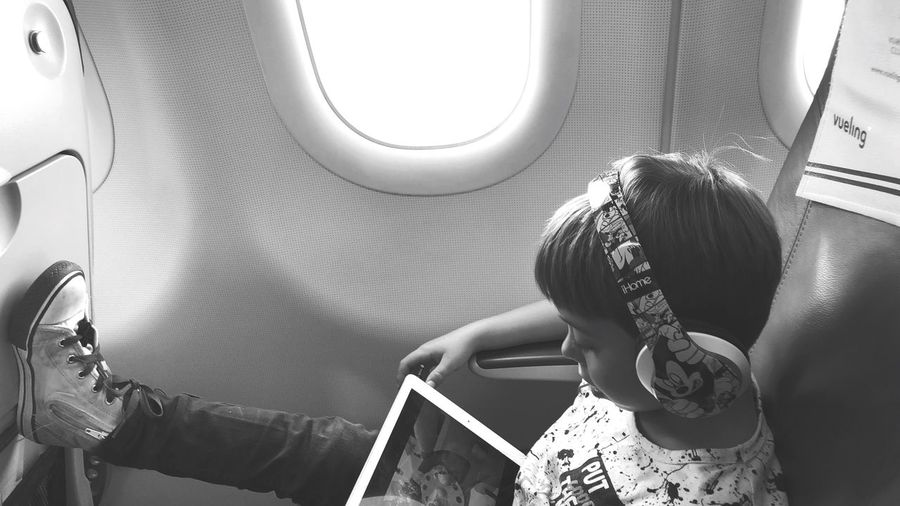 Real People Lifestyles Window One Person Day Indoors  Vehicle Interior Mode Of Transportation Childhood Journey Child Travel Transportation Airplane Sitting Air Vehicle EyeEmNewHere