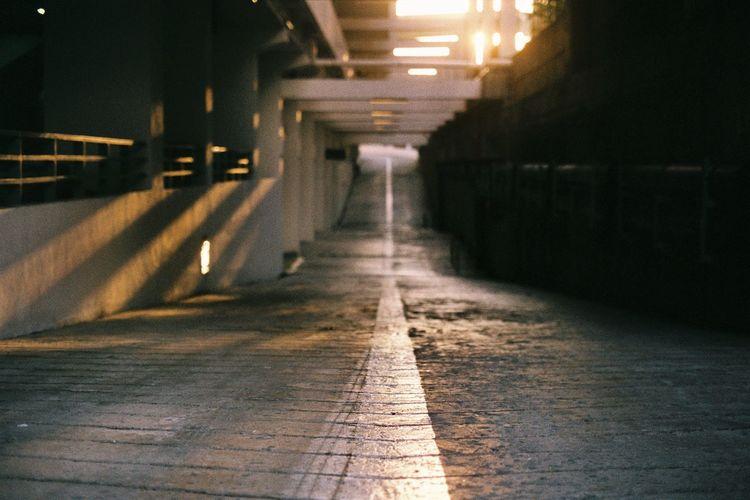 Empty road in building basement