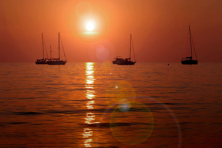 Nautical Vessel Transportation Water Mode Of Transportation Sailboat Sea Sunset Sky Scenics - Nature Sailing Reflection Beauty In Nature Tranquil Scene Sun Tranquility Pole Nature Idyllic Travel No People Outdoors Yacht