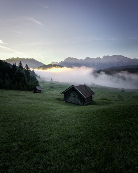 Cabin with a beautiful mountain view. Sunrise and clouds. Mountain Sky Grass Scenics - Nature Plant Tranquil Scene Green Color Beauty In Nature Field Architecture Built Structure Tranquility Environment House Landscape Land Fog No People Mountain Range Outdoors Cabin Sunrise Mood Cloud - Sky Cabins  My Best Photo