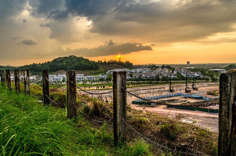 Hillside Sunrise_sunsets_aroundworld Sunrise Sun Nature Hill Sunset Sky Cloud - Sky Chainlink Fence Fence Boundary Sunbeam Shining Amusement Park A New Beginning EyeEmNewHere