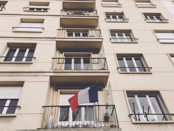 Low angle view of french flag on balcony