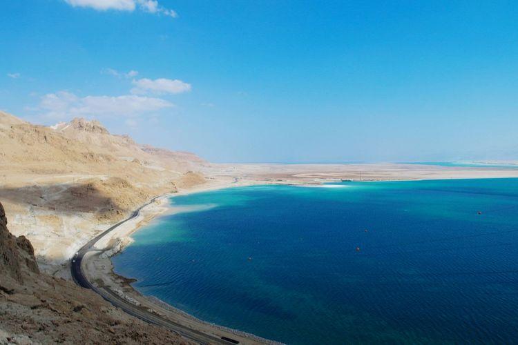 View of calm blue sea against blue sky