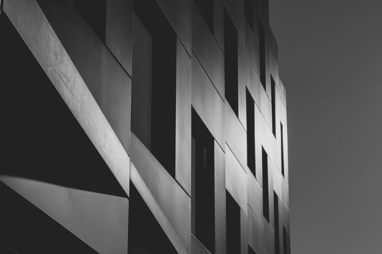 Architecture Built Structure Building Exterior Building No People City Modern Low Angle View Pattern Day Window Wall - Building Feature Outdoors Glass - Material Geometric Shape Close-up Shadow Office Building Exterior Apartment Black And White Sunlight