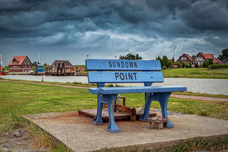 Sundown Point bench Cloud - Sky Architecture Built Structure Sky Building Exterior Grass Nature Building Day Land No People Water Overcast House Plant Outdoors Northsea Butjadingen Coast Bench Cloudy Sky Text Travel Destination Raining Day EyeEmNewHere