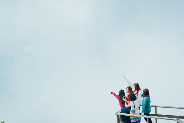 People standing against sky