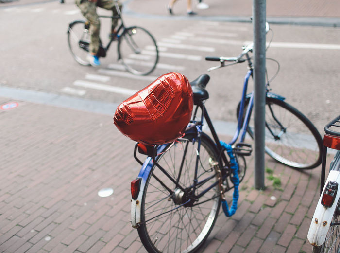 Baloon Bicycle City Cycling Day Focus On Foreground Heart Land Vehicle Mode Of Transport No People Outdoors Red Red Road Stationary Transportation Place Of Heart A New Perspective On Life #NotYourCliche Love Letter Streetwise Photography