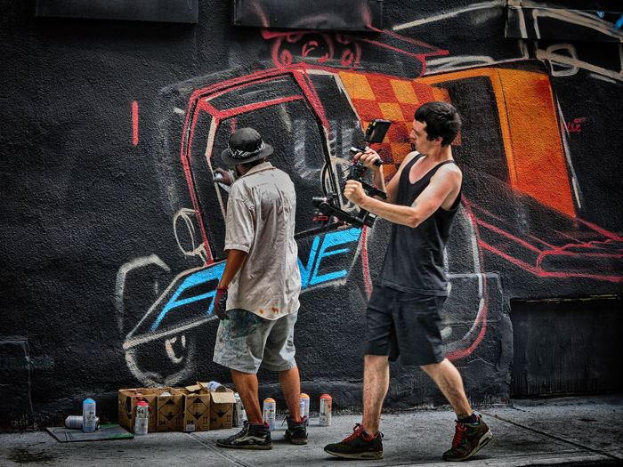 Artist Casual Clothing City Life Day EyeEm Best Shots EyeEm Gallery Eyeem4photography Full Length Leisure Activity Lifestyles Live Performance  Outdoors Painting Art Streetphotography Wall Painting Warm Clothing Color Palette Capture The Moment The Scene ✌livee Capturing Movement The Street Photographer - 2017 EyeEm Awards