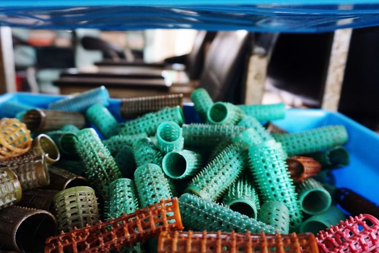 Hairroll Close-up Still Life No People Large Group Of Objects Green Color Indoors  Focus On Foreground Day Equipment Stack Metal Container For Sale Abundance Choice Selective Focus Multi Colored Variation Table Turquoise Colored