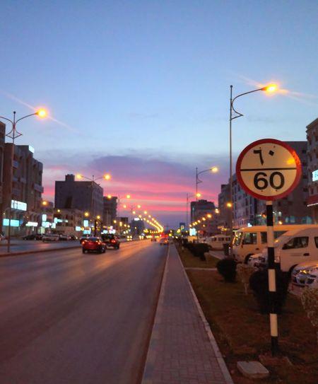 Traffic on road at dusk