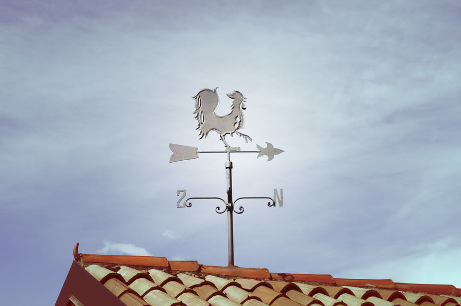 Weathercock on the Rooftop Arrow Rooftop Weathercock Building Exterior Cloud - Sky Compass Decoration Direction House Instrument Meteorology No People Outdoors Roof Rooster Sky Weather Vane Wind Direction Indicator