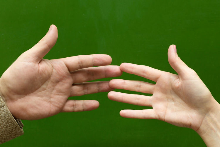 Cropped image of people hand against blurred background