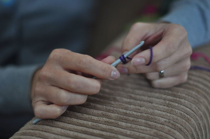 Cropped Image Of Woman Hands Knitting Wool