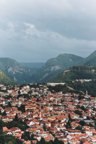 BIH Bosnia And Herzegovina Architecture Beauty In Nature Bosnia Building Exterior Built Structure Cityscape Crowded Day House Mountain Mountain Range Nature Outdoors People Roof Sarajevo Scenics Sky Tiled Roof  Town Tree
