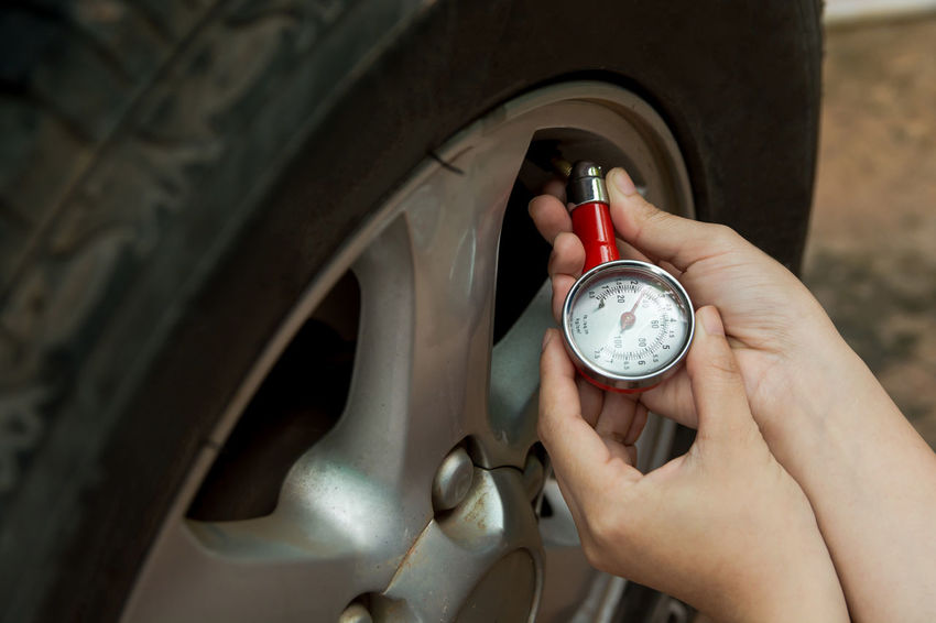 Tire pressure gauge : Hand holding pressure gauge checking air pressure for car tire. Safe driving. Caucasian Ethnicity, Checking In Driving Machinery Measuring Mechanic Pressure Gauges Transportation Wheel Working Auto Mechanic Auto Repair Shop Car Caucasian Ethnicity Equipment Examining Gauge Human Hand Instrument Of Measurement Physical Pressure Pressure Gauge Safe Driving Tire Tire Pressure Transportation Building - Type Of Building