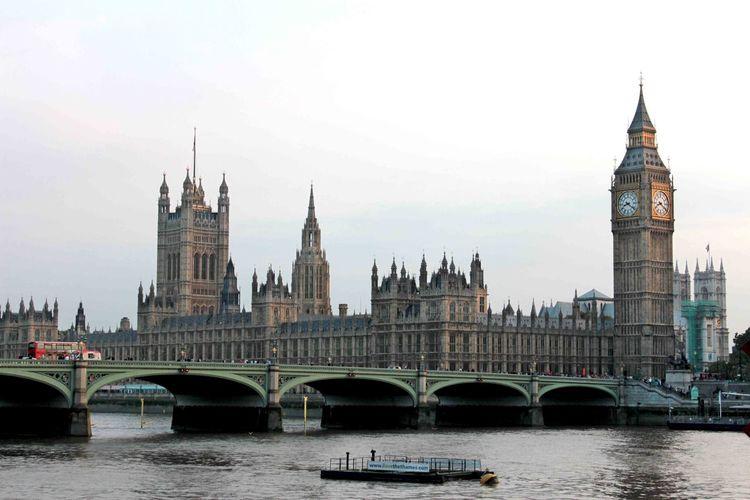 Bridge over thames river with landmark in background