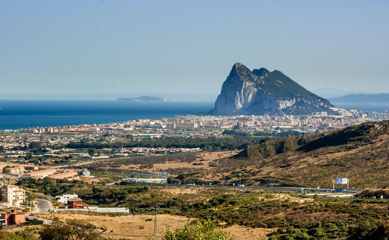 A view of the Rock of Gibraltar with the Spanish town of La Linea de la Concepcion taken from Spain Gibraltar Rock Gibraltar Views Gibraltar And Sea La Linea De La Conception View Of Gibraltar View Of Gibraltar From Spain Beauty In Nature City Cityscape Clear Sky Day Gibraltar Horizon Over Water Landscape No People Outdoors Residential District Scenics - Nature Sea Sky TOWNSCAPE Tranquil Scene Water