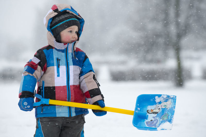 boy and snow Winter Snow Cold Temperature Child Childhood One Person Warm Clothing Boys Males  Real People Leisure Activity Men Clothing Three Quarter Length Standing Cute Day Front View Innocence Snowing Outdoors Game