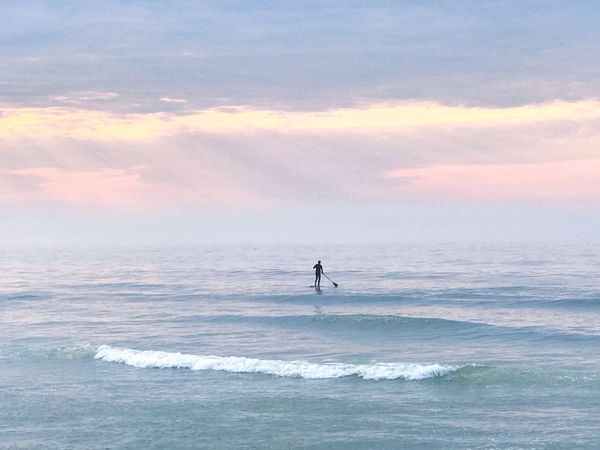 Sea Water Nature Horizon Over Water Beauty In Nature Scenics Wave Leisure Activity Sport Cloud - Sky Outdoors Silhouette Clouds And Sky Early Morning Ocean View Beachphotography EyeEm Nature Lover Life Is A Beach Tranquil Scene Paddleboarding Sky Ocean Tranquility On Vacation Sommergefühle