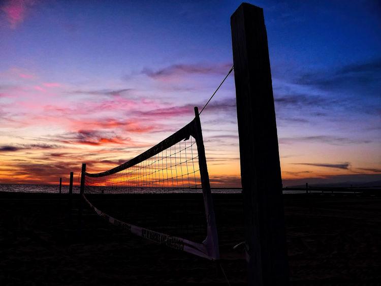 Sunset Beach Volleyball Atmosphere Beach Colorful Sky Dusk Outdoors Silhouette Sky Sunset Sunset Silhouettes Volleyball
