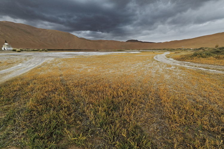 1104 sumu jaran lakebed among the badain jaran desert sand dunes. inner mongolia-china.