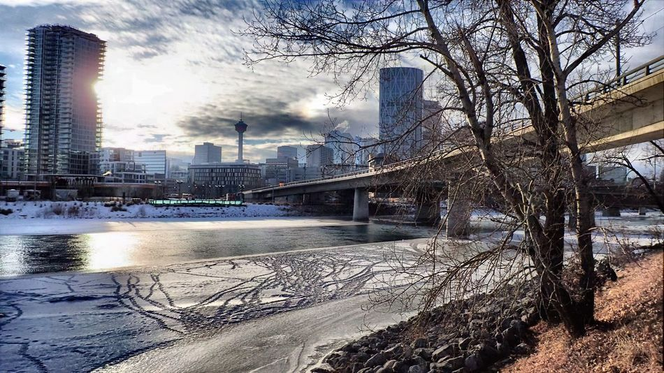 Sirius weather. Bow River Connection Diminishing Perspective Husky Tower Mass Transit River City Riverfront Sun Dog Tracks