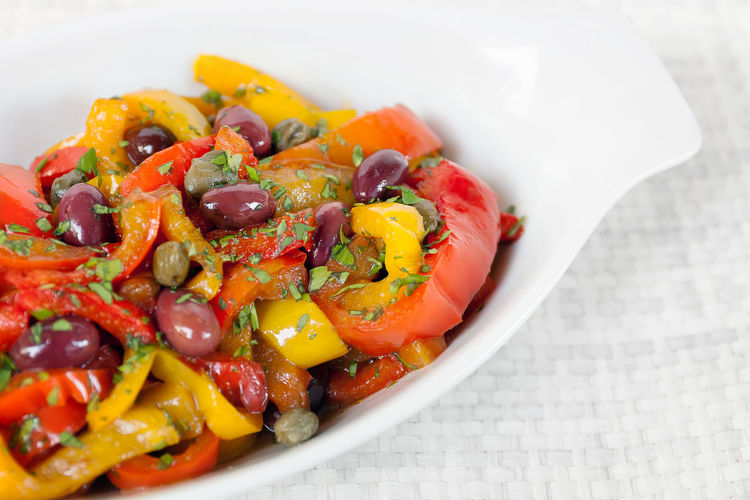 Peppers cooked in pan with oil, olives and capers. Typical Italian cuisine, ready to eat. White bowl on white background. Capers Close-up Day Food Food And Drink Freshness Healthy Eating Indoors  Multi Colored No People Olive Olives Orange Color Peppers Peppers, Fresh, Colorful, Organic Ready-to-eat Red Pepper Yellow