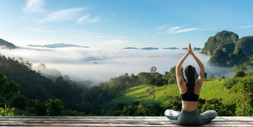 Young woman practicing yoga in the happiness. Landscape background ASIA Cloud Happiness Happy Holiday Morning Nature Tourist Travel Woman Yoga Backgrounds Beauty Concentration Fit Fitness Fog Fresh Healthy Lifestyles Mist Mountain Relax Resort Resting The Traveler - 2018 EyeEm Awards