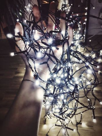 Lighten up! Light And Shadow Playing With Light Lights Light Chains Lichterkette Holding Light Hand From My Point Of View Picking Up Lightchain Lights In The Dark Little Lights Christmas Lights Dramatic Lighting Indoor Lighting Decoration Glowing Illuminated Atmosphere Dark Glowinthedark Capture The Moment