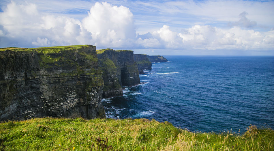 Beauty In Nature Cliff Cloud - Sky Day Grass Horizon Over Water Nature No People Outdoors Physical Geography Rock - Object Scenics Sea Sky Tranquil Scene Tranquility Travel Destinations Water