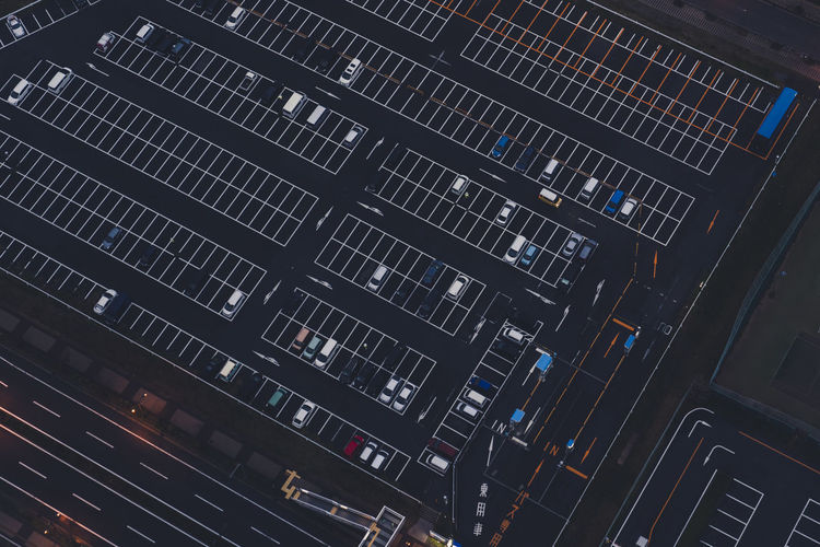High angle view of cars parked in lot at night