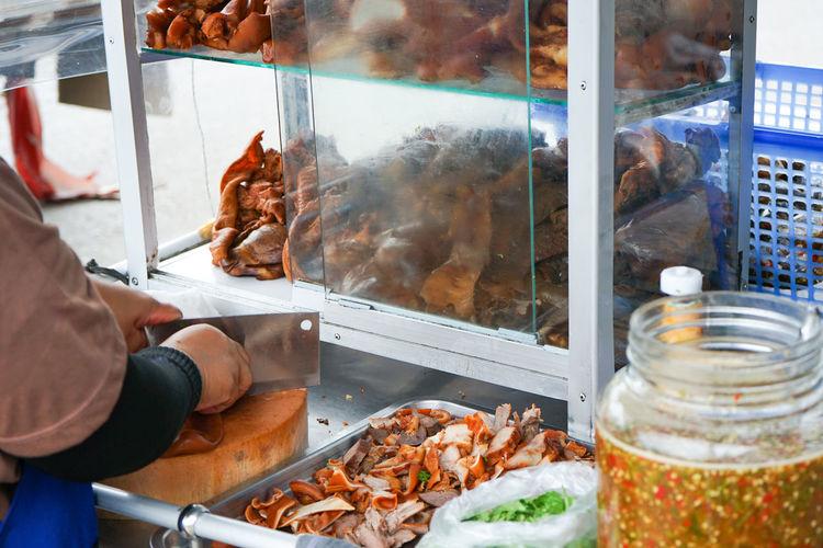 Man preparing food at store