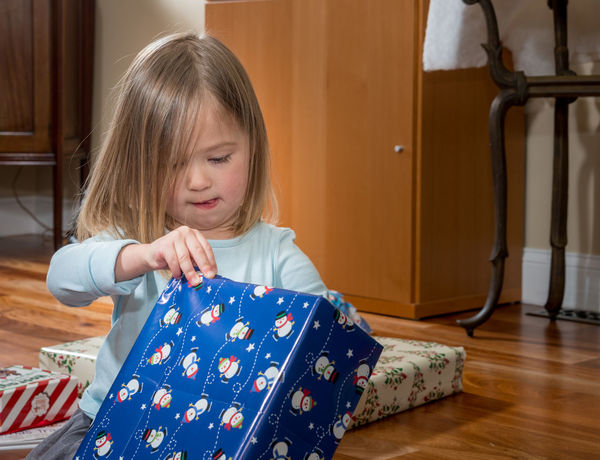 Happy preschool toddler with christmas gifts and presents Christmas Happy Preschool Age Presents Xmas Child Childhood Cute Gift Girl Parcel Portrait Pretty Toddler  Unwrapping