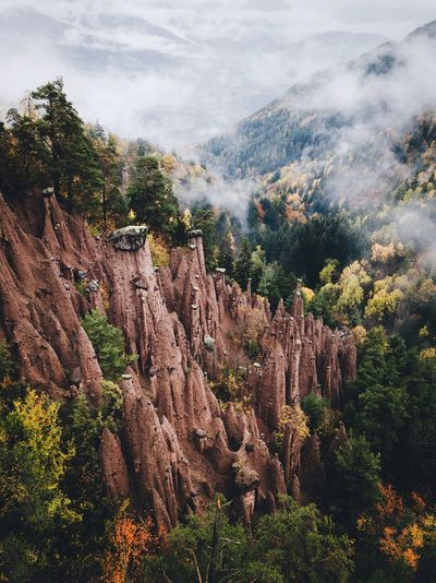 Earth pyramids in South Tyrol South Tyrol Landscape Autumn Nature VSCO Mountain Tree Plant Beauty In Nature Growth Cloud - Sky Scenics - Nature Sky Nature Mountain Tranquility No People Tranquil Scene Day Environment Land Mountain Range Outdoors Non-urban Scene Low Angle View Landscape